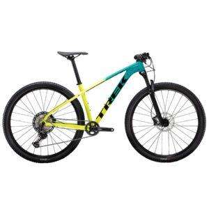 En mountainbike cykel från TREK. Modellen är X-caliber 9 i gult och petrolfärgat utförande